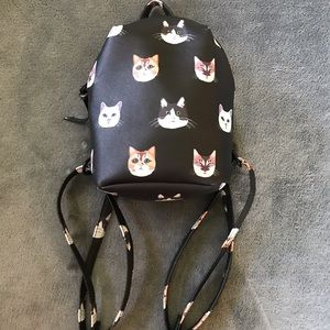Small cute cat backpack.